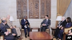 Special Envoy for Syria Kofi Annan, center left, Norwegian Maj. Gen. Robert Mood, head of the U.N. observer team in Syria, 3rd left, Syrian President Bashar Assad, center right, and Syrian FM Walid Moallem, 2nd right in Damascus, Tuesday, May 29, 2012.