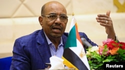 FILE - Sudan's President Omar Hassan al-Bashir speaks during a press conference at the palace in Khartoum, March 2, 2017.