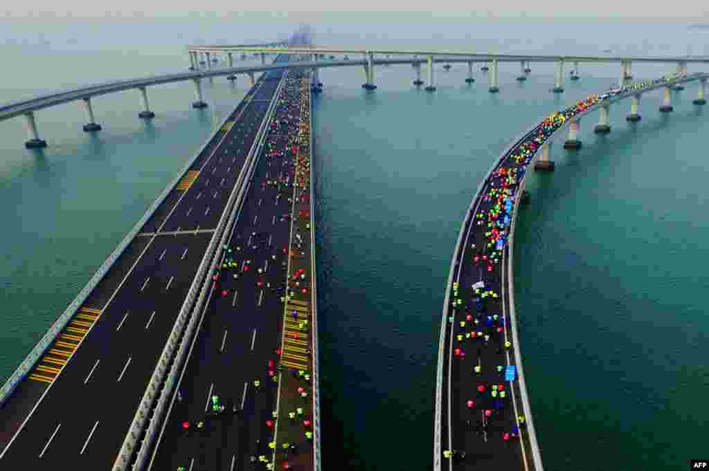 This photo shows participants crossing the Jiaozhou Bay Bridge as they compete in the 2017 Qingdao International Marathon on the Sea in Qingdao in China's eastern Shandong province.