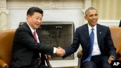 美國總統奧巴馬和中國國家主席習近平誓言通過解決彼此間的分歧來加強美中雙邊關係。