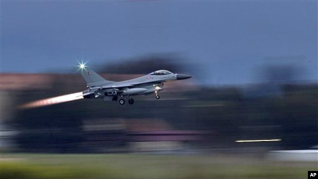 A Danish F-16 fighter-bomber takes off from the NATO airbase in Sigonella, Italy,  March 21, 2011