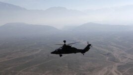 A German Bundeswehr armed forces Tiger attack helicopter flies next to the Marmal mountain near Camp Marmal in Mazar-e-Sharif, northern Afghanistan December 20, 2012.    REUTERS/Fabrizio Bensch (AFGHANISTAN - Tags: MILITARY CONFLICT POLITICS)