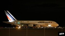 Air France Airbus 380, Flight 65, sits on the runway at the Salt Lake City International Airport being inspected by the FBI on November 17, 2015 in Salt Lake City, Utah.