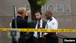 FILE - United States Secret Service police are seen standing in front of the Ethiopian Embassy in Washington Sept. 29, 2014, in connection with a shooting incident at the compound.