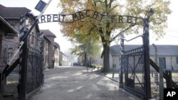 FILE - Entrance of Auschwitz at the former Nazi German death complex of Auschwitz-Birkenau in in Oswiecim, Poland.