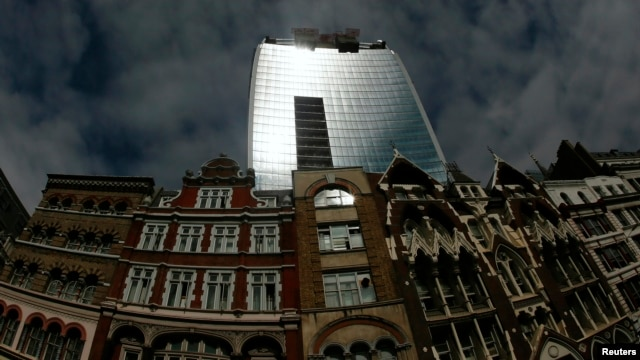 Sunlight is reflected from the Walkie Talkie tower in central London, Sept. 3, 2013.  Courtesy: Reuters
