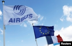 Flag with Airbus logo is pictured next to European and French flags at the Airbus A380 final assembly line at Airbus headquarters in Blagnac near Toulouse, France, March 21, 2018.