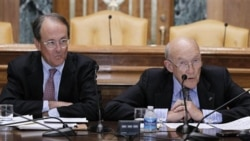 Democrat Erskine Bowles, left, and Republican Alan Simpson meet with reporters in Washington to present their plan for reducing the government's budget deficit