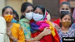 Porodica preminulog od Kovida 19 u Indiji