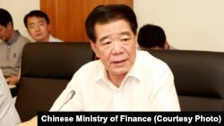Mo Jiancheng speaks at a Ministry of Finance meeting, August 18, 2017, in Beijing.