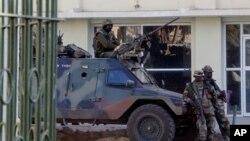 Members of the regional ECOWAS force keep guard at Presidence palace in Banjul, Gambia, Jan. 23, 2017.