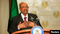 FILE - Sudan President Omar al-Bashir speaks to the media in state house in capital Juba during his visit to South Sudan, Jan. 6, 2014.