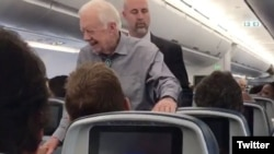 Former president Jimmy Carter shakes hands with every passenger on a recent flight from Atlanta, Georgia, to Washington, D.C. (Twitter - @UPROXX)