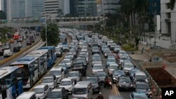 FILE - Motorists are stuck in traffic jam during a rush hour at the main business district in Jakarta, Indonesia, Dec. 11. 2018.