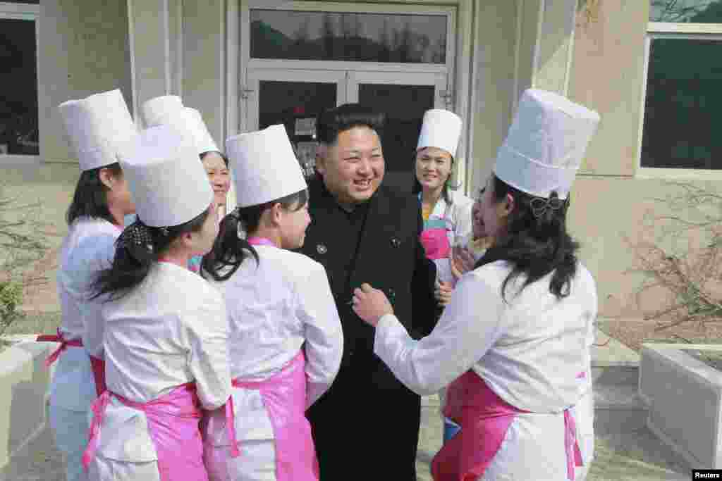 North Korean leader Kim Jong Un smiles during his inspection of Unit 1016 of KPA (Korean People's Army) Air and Anti-Air Force honored with the Title of O Jung Hup-led 7th Regiment, in this undated photo released by North Korea's Korean Central News Agency in Pyongyang.