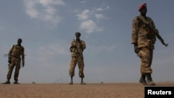 Sudan People's Liberation Army (SPLA) soldiers guard the airport in Malakal, Jan. 21, 2014.