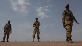 FILE - Sudan People's Liberation Army (SPLA) soldiers guard the airport in Malakal, Jan. 21, 2014.