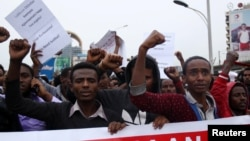 FILE - Protesters chant slogans during a demonstration in Ethiopia's capital Addis Ababa, Aug. 6, 2016.