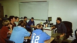 Michael Bair teaches teamwork, reading, writing, computer skills and public speaking in his ninth-grade English class for boys