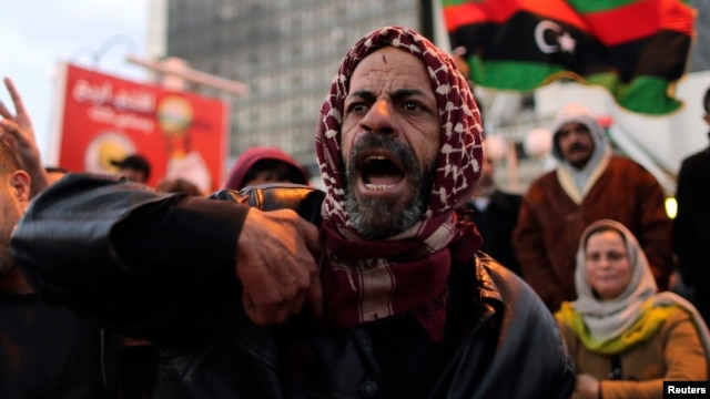 A man shouts during a demonstration against what the protesters said was the decision of the National Congress to extend the period of their stay in power, in Benghazi December 27, 2013.