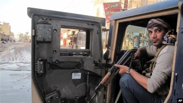 Tribal fighter sits in Humvee during joint patrol with Iraqi security forces in Ramadi, 70 miles (115 kilometers) west of Baghdad, Jan. 30, 2014.