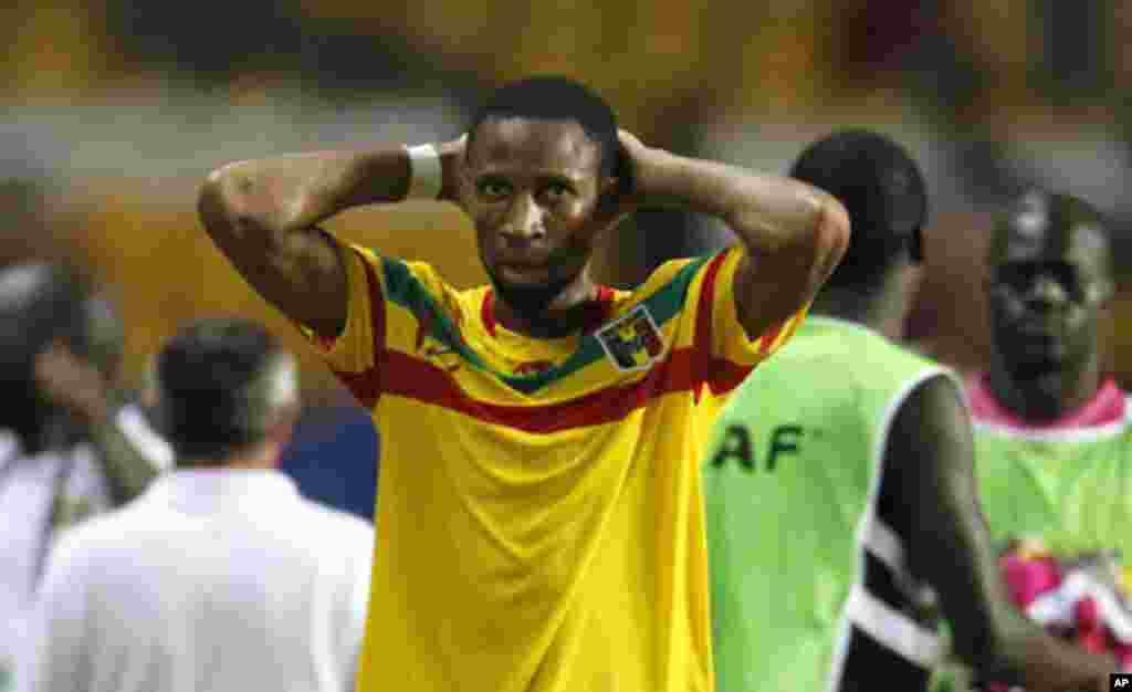Mali's Seydou Keita reacts after their final African Cup of Nations Group D soccer match against Botswana at the Stade De L'Amitie Stadium in Libreville February 1, 2012.