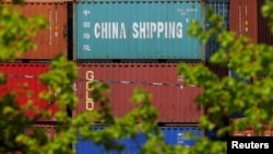 FILE - Shipping containers are stacked at the Paul W. Conley Container Terminal in Boston, May 9, 2018. According to Chinese data, China's trade surplus with the United States rose $24.58 billion in May.