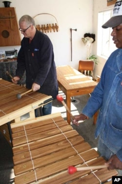 AMI's Christian Carver (left) and Mark Komsana play 'quintessential' and 'louder' African marimbas