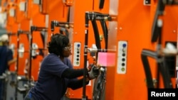 A BMW employee works on the door assembly for the X4 at the BMW manufacturing plant in Spartanburg, South Carolina.
