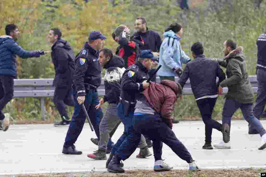 Migrants clash with Bosnian police in Maljevac, Bosnia. Bosnian police blocked hundreds of migrants from crossing into Croatia, a European Union member, reflecting tensions as the country struggles with the influx.