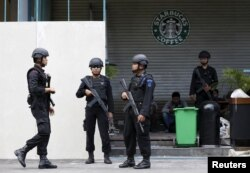 FILE - Indonesian police stand guard at the site of this week's militant attack in central Jakarta, Indonesia, Jan. 16, 2016.