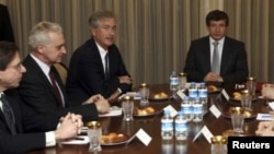Turkey's Foreign Minister Ahmet Davutoglu (R) and U.S. Deputy Secretary of State William Burns (3rd L) meet as they are flanked by U.S. officials in Ankara January 9, 2012.