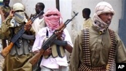 Shabab militia patrol Bakara Market in Mogadishu (File)