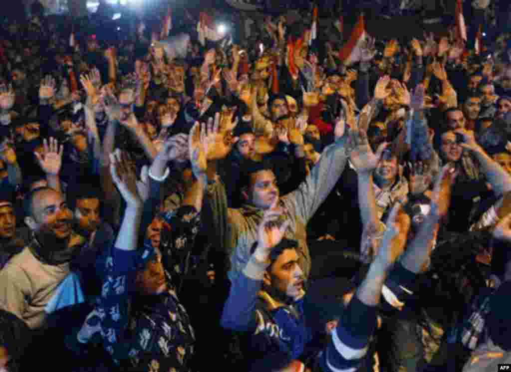 Egyptian citizens celebrate after President Hosni Mubarak resigned and handed power to the military at Tahrir Square, in Cairo, Egypt, Friday, Feb. 11, 2011. Egypt exploded with joy, tears, and relief after pro-democracy protesters brought down President