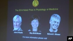 Images of the winners of the 2014 Nobel Prize for Medicine, U.S.-British scientist John O'Keefe and Norwegian husband and wife Edvard Moser and May-Britt Moser are projected on a screen during the announcement in Stockholm Monday Oct. 6, 2014.