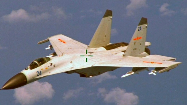 FILE - A U.S. military official says two Chinese J-11 fighters, like one pictured here, flew out to intercept a U.S. EP-3 Aries aircraft, coming so close that they forced the pilot to descend a couple hundred feet.