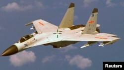 Chiến đấu cơ J-11 của Trung Quốc bay trên bầu trời phía đông đảo Hải Nam.