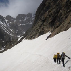 Rangers in Rocky Mountain National Park, Colorado, crossing the snowfield on Longs Peak on the way to Chasm Lake