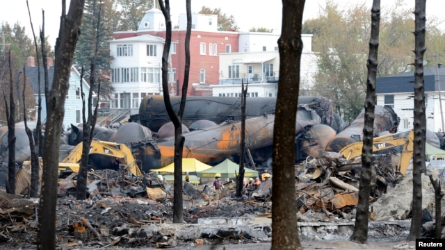 An emergency worker stands on the site of the train wreck in Lac Megantic, Quebec, Canada, July 16, 2013.