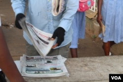 A newspaper vendor is seen in Westfield, Banjul, Gambia, June 7, 2017.