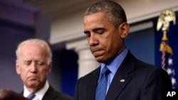 Presiden AS Barack Obama didampingi Wapres Joe Biden memberikan komentarnya atas penembakan di kota Charleston, South Carolina, hari Kamis (18/6).