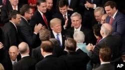川普總統1月31日在國會參眾兩院聯席會議上發表首次國情咨文演講前。