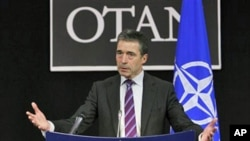 NATO Secretary General Anders Fogh Rasmussen speaks during a media conference after a meeting of NATO defense ministers at headquarters in Brussels, March 10, 2011