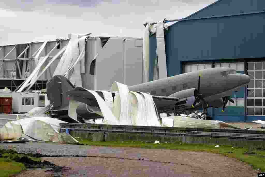 Parts of the roof of the Theatre Hangar are seen on the Dakota airplane after the roof was partially blown away by strong winds at the former airfield in Valkenburg, The Netherlands. The Dakota airplane is being used in the musical Soldier of Orange.