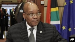South Africa's President Jacob Zuma, attends a meeting with European Council President Herman Van Rompuy, and European Commission President Jose Manuel Barroso, at the European Council building in Brussels, Tuesday, Sept. 28, 2010. (AP Photo/Yves Logghe)