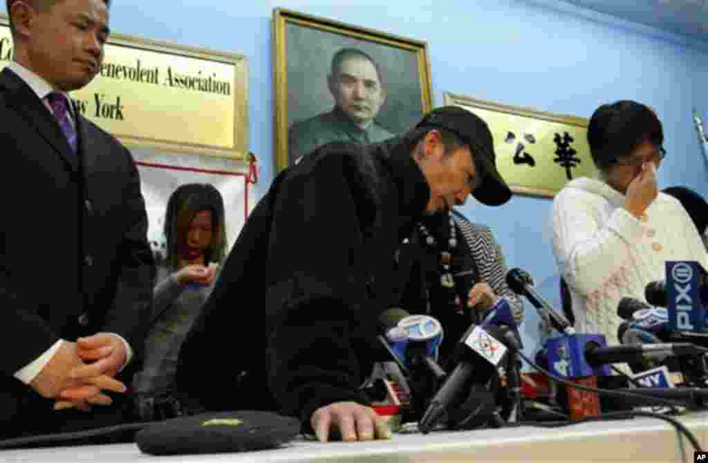 City comptroller John Liu, far left, listens as the father of Pvt. Danny Chen, Yan Tao Chen, center, speaks while his mother Su Zhen Chen, far right, weeps during a press conference in New York, Thursday, Jan. 5, 2012. (AP)