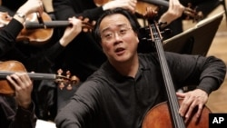 FILE - Cellist Yo-Yo Ma at a rehearsal of Rhode Island Philharmonic at the VMA Arts & Cultural Center in Providence, R.I., March 7, 2006.