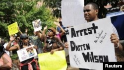 Protestors at the St. Louis County Justice Center call for the arrest of Police Officer Darren Wilson in Clayton, Missouri, Aug. 20, 2014.