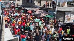 Demonstrators march through the streets of Port-au-Prince during an anti-government protestDecember 5, demanding the resignation of Hatian President Michel Martelly.