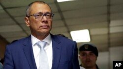 FILE - Ecuador's jailed Vice President Jorge Glas is escorted back to the courtroom for the judge's decision regarding his lawyer's habeas corpus request at the National Court, the country's highest court, in Quito, Ecuador, Oct. 15, 2017.